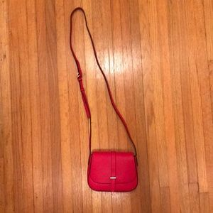 Small red crossbody purse with snap closure